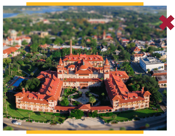 Zoomed out photo of main Flagler Campus building